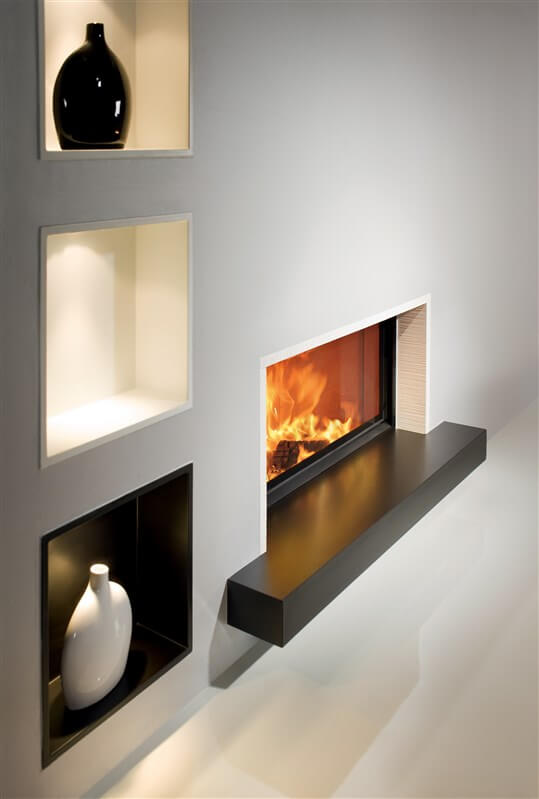 Architectur Fireplace 45-101 in a puristic white room with tiles from Sommerhuber diagonal shot